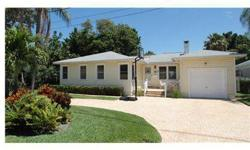 Make every day a vacation in this charming Clearwater Beach retreat. Overlooking the gentle activity of the Clearwater marina, this spacious 3 bedroom cottage offers a large fenced yard, new pool and spa and dock with davits. The home features hardwood