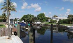 Beautiful waterfront home with almost new SS appliances.Pool over looks canal.Fantastic location!Granite counter tops,two convection ovens. Baths have been redone in marble. Large corner lot.Bring offers.