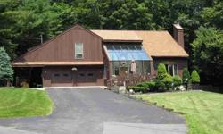 This home offer use of a dock/mooring on a rotational basis on Lake George. Spacious rooms with gas fireplace in living room, soapstone wood stove in den, floor to ceiling windows and radiant heat in family room, 3 bedrooms, 1.5 baths, loft ideal for