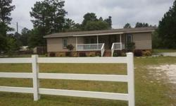 Attractive 3 bedroom, 2 bath manufactured home with updates to include laminate hardwood flooring, beautiful kitchen cabinets, black appliances, GE refrigerator remains. Large country front porch to relax on-great rear deck perfect for grilling. Split