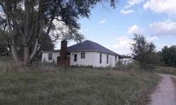 Here is your Country Getaway! Cute Bungalow. Huge master bedroom,main floor laundry, country kitchen, fireplace. Large deck/porch on back of home. 4.7 acres with pond, fenced area for horses or other livestock, 36x24 oversized garage/shop with concrete