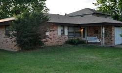 Wonderful brick home with porch. New Roof. Laminate wood flooring in living, dining, kitchen and hall. Carpet in all bedrooms. Ceiling fan in each bedroom. 1 and 1/2 baths. 1 car attached garage. Listing originally posted at http