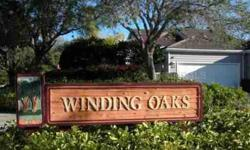 """SEASONAL VACATION RENTAL. Longboat Keys most desirable gated community. Enjoy lakefront views in this turnkey furnished villa """"behind the gates"""" in Winding Oaks. A secluded garden entry leads into a spacious 2-bedroom and 2-bath residence with attached"""