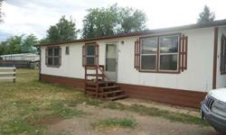3 bedroom, 2 bath, manufactured home in Lochbuie. Chain-link fenced and gated lot of 6700 square feet. Plenty of off-street parking with room for a garage. Buy for less than rent! Was rented at $800 per month. Conventional or cash. May go FHA. Seller will