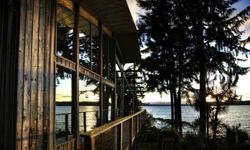 Wow Factor! Hint of Frank Lloyd Wright-style. A true Beach House to experience NW Island Living at its best! What an Organic & Warm feeling in this home with exceptional space. Light dances throughout this home as the sea-scape paints ever-changing views.