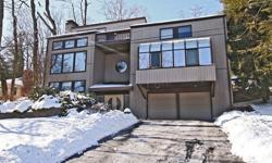 West Orange, NJ 4 Bed 2.1 Bath HOME FOR SALE $629,000Drop dead Gorgeous! This unique,multi-leveled, updated Contemporary on a quiet dead end street features a large new kitchen w/center island with sliders to patio,deck and a beautifully terraced yard on