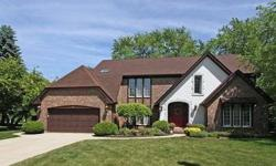 FABULOUS EXECUTIVE HOME ON A BEAUTIFULLY LANDSCAPED LOT! This stunning Tudor has amazing details