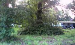 In Summerville, South Carolina, Knightsville Area 2 Acre Tract Of Land With A Double Wide On It Built In 1981 3 Bedroom 2Baths Nested On A Half Block And Is Occupied. A Great Investment Property For A Growing Area Or Starter Home. Listing originally