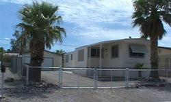 Location, location, near the Bullhead City Community Park and public boat launch to Colorado River. Close up view of the Laughlin, NV casinos. On a cul-de-sac, this singlewide mobile home is extremely clean and ready to move in, includes a detached garage