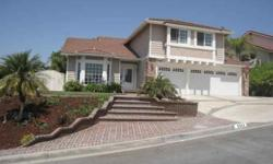 Tastefully upgraded 4 br/2.5 bath home located in quite Yorba Linda neighborhood. Cul-de-sac location and homes in the area are well maintained. Neutral decor/colors used. Move in condition! Formal entry to living room and dining area. Travertine flooring