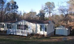 This 3 bedroom 2 bath home sits adjacent to beautiful Lake Bowen and is ready to move into. It has been upgraded with new tile, carpet, (2 bedrooms) paint,light fixtures and ceiling fans. Also included is a wood burning fireplace, all appliances,paved