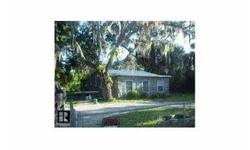 LOCATION WITH POTENTIAL FOR COMMERICAL ZONING. 2 BED/1 BATH HOME ON ALMOST A 1/4 ACRE-ENCLOSED PORCH WITH VIEW OF WATER GARDEN POND-PROPERTY IS FENCED,SHED FOR STORAGE,CIRCLED DRIVE WITH PLENTY OF ROOM FOR BOAT AND R.V. JUST A FEW MINUTES F ROM PORT OF