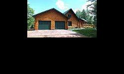 Situated on the end of a peninsula on Moon Lake sits this gorgeous Golden Eagle Log Home! Spectacular lake views from every single window with nearly 500' of sandy shoreline surrounding the property. Majestic great room with floor-to-ceiling windows, a