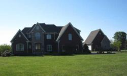 SPECTACULAR CUSTOM BUILT HOME WITH HDWD THRU-OUT EXCLUDING CLOSETS & BOTH BONUS ROOMS. TILE IN ALL WET AREAS. SEP 2 CAR GAR W/TILE FLOORS, 1/2 BATH & UNFINISHED AREA ABOVE. BEAUTIFUL ACREAGE WITH PRIVACY.Listing originally posted at http