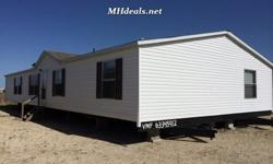"""Double wide manufactured home with 5 bedrooms and 3 bathrooms. this home has a few luxuries like a 60"""" garden tub and separate shower in master bathroom, beautiful fireplace in living area, and a chandelier in dining area. Home stands at 2176 square feet"""
