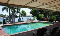 """Rare 100 ft of Waterfront on Lettuce Lake/Spanish River on the east side of the Intracoastal looking to wide views of Lake Santa Barbara. 10 foot ceiling on this beautiful """"good bones"""" home in excellent condition. 2 boat lifts, 10,000 lbs. New A/C, New"""