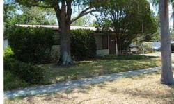 Active with contract. NOT A SHORT SALE OR BANK OWNED. Spacious, well cared for 3 bedroom, 2 bath home on treed corner lot ready for new owner. Relax in either the large family room or outside in the large screened and covered lanai. Mast er bedroom has