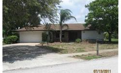 Large Family Home. This 3 bedroom two bath home is located in well maintained subdivision. Property features large screened in area with built in jacuzzi great for entertaining. The familyroom has fireplace surrounded by ceramic tile. A must see.