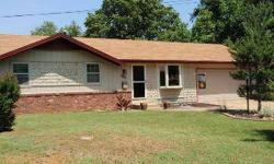 Absolutely Adorable! Get ready to fall in love with this absolutely charming ranch home with darling decor, newer carpet, paint and a 3 year old roof!. Nice open floor plan with brick woodburning fireplace accenting the kitchen / dining area and Great