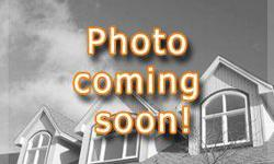 Split level home on corner lot. Enter the foyer and go up the stairs into the living/dining area which connects to your kitchen and eat in. Nice open floor plan. All white appliances in the kitchen will convey. Off the dining room are sliding glass doors