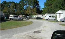 Mobile home park with 38 pads. 36 Trailers currently on-site. thirteen mobile homes convey with purchase. City water and sewer individually metered. Paved roads. Spacious lots well groomed and maintained.Listing originally posted at http