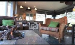 The Ultimate car collectors dream home. This is not only a luxury residence but has a fully air conditioned and finished 2400 sf garage currently used to house a pristine collection of cars, but could be easily converted to an in law apartment. This is a