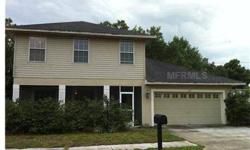 SHORT SALE. Nice 2 story home within walking distance to Lake Ariana. 3 bedroom 2.5 bath. Wood floors in living room. Formal dining area. Inside laundry area. All bedrooms have walk-in closets. Dual sinks in master bath. Lakeview from front yard. Close to
