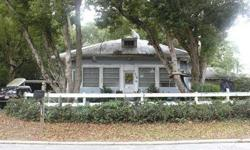 SHORT SALE. Historical home close to downtown Lake Gracie right down the street 28x11 workshop, hardwood floors 10 foot ceilings, large sunroom, cozy home in good condition.Attic has floor large enough to convert to 3rd bedroom & bath lots of