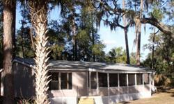 Florida Home For Sale By Owner - Located in Central Florida, Lake County, 2.67 acres with 3/2 roomy manufactured home, (1990) with living room cathedral ceiling, eat in kitchen, separate dining room, large front porch, master bedroom has bath with tub and
