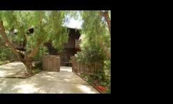 A very charming home nestled in the Santa Mountains conveniently located between Malibu and Calabasas in Monte Nido. This unparalleled two story 3 BR 2BA home features a large bonus/office/studio (with a private entrance), spacious decks for dining al