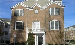 Gorgeous 3 Level End Unit TH w/Gourmet Eat In Kitchen, SS Appl & Granite Ctops. Hardwoods Thruout Main LVL, 2 Sided Gas FP, 2 Car Garage, Mstr Bdrm w/ vaulted ceilings, Luxry Bath w Sep Showr & His/Her Sinks, & WI Closet. 5 Ceilings Fans Thruout. Lower