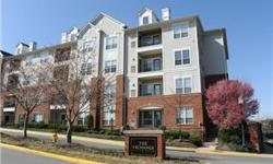 Terrific unit in great location w/2 garage spaces has crown molding in living/dining rooms, kitchen w/granite counters, stainless steel appliances, 42-inch cabinets, track lighting & pass-thru w/built-in wine rack to dining room, living room w/door to