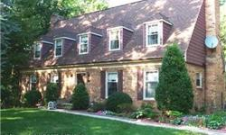 Huge brick front colonial w/ 6 BR & 4.5 BA on 3/4 Acres on cul-de-sac! Private lot with large deck & view of trees. Hardwood throughout. Large rooms. Recently updated kitchen with granite, maple and recessed lights. Bedrooms: 6 Full Bathrooms: 4 Half