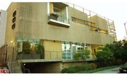 Pugh & Scarpa designed Tri-Level Loft will inspire you. 1 or 2 bedroom (depending on how you configure) in the heart of Hollywood. Very high ceilings, concrete floors, stainless steel kitchen, 2 baths, roll up door, washer/dryer inside, two balconies and