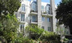 Elegant Chateau Paliset condominium facing Haverford Street with lovely views of the mountains, trees and afternoon sunsets. With great natural light and most desirable Palisades Village location this 2 bedroom 2 bath unit, offers a spacious living room