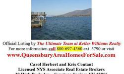 Sprawling family compound directly on the lake. Stunning views of Harris Bay at this great Assembly Point location. Big house has 2 complete kitchens, HUGE dining area, great stone fireplace, several cozy family rooms w/ lake views. Property also has 2