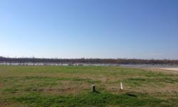 beautiful, large 0.79 acre lot on the lake in the back of Tennyson Oaks
